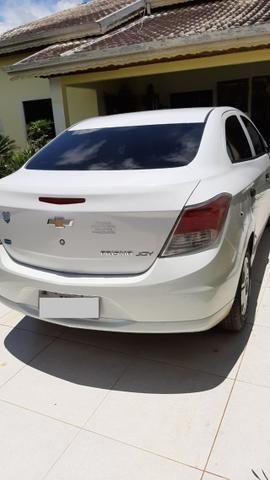 Prisma Joy 1.0 seminovo Branco Impecável carro de mulher - Foto 5