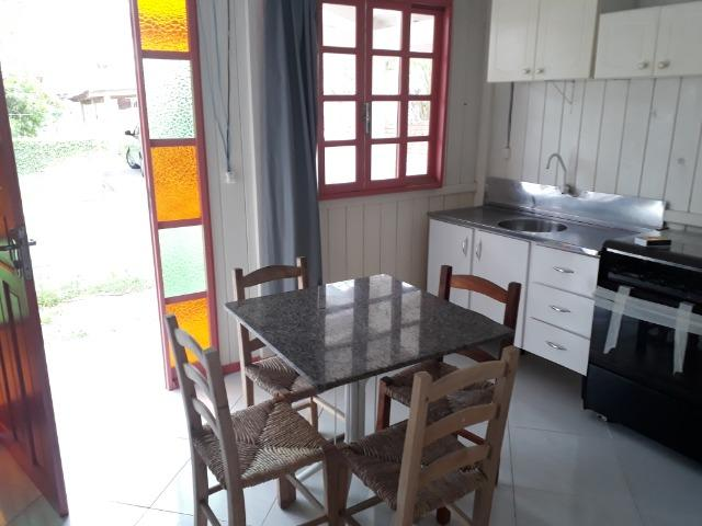 Vendo pequena casa de madeira na Pinheira - Foto 8