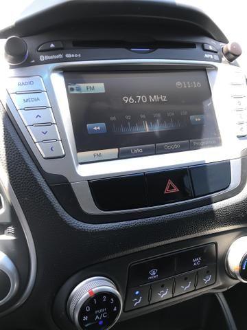 Hyundai IX 35 2015 branca Flex Aut. IMPECAVEL - Foto 17