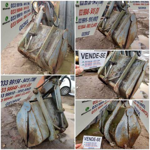 Unha hidraulica,que abre e fecha,para pegar areia brita carvão,ou o que quizer