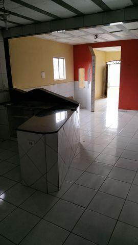 Casa com primeiro andar - Foto 4