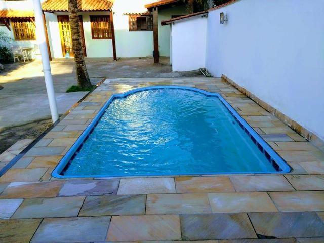Casa com quintal, espaço gourmet com churrasqueira, piscina, espaço fitness, laguinho, etc - Foto 4