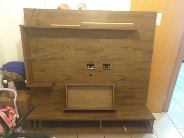 Estou vendendo uma rack de parede de TV semi usada bem conservada
