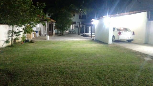 Casa com quintal, espaço gourmet com churrasqueira, piscina, espaço fitness, laguinho, etc - Foto 6