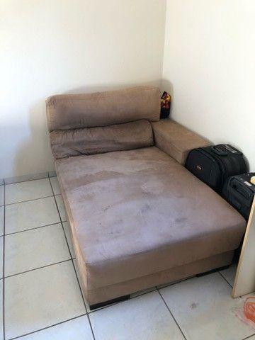 Vendo parte de um sofá