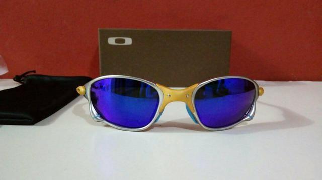2ddd79fa4a3a5 Óculos de sol Oakley Doublex 24k xmetal lente azul Novo ...