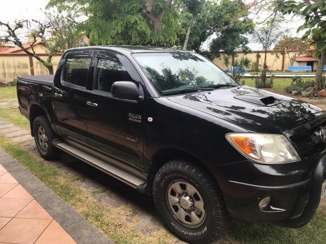Toyota Hilux CD SR 4x2 4 portas preta em perfeito estado - Foto 2
