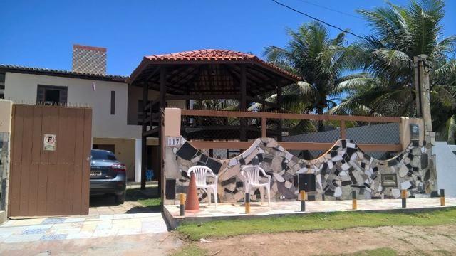 Vendo uma formosa casa, defronte ao mar, em JAUÁ (pé na areia) Valor R$450.000,00