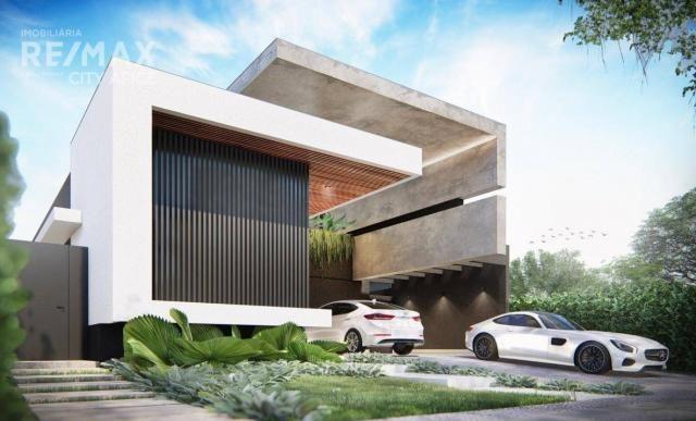 Casa com 3 suítes à venda, 211 m² por R$ 1.290.000 - Parque dos Novos Estados - Campo Gran