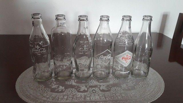 Garrafas antigas da Coca Cola
