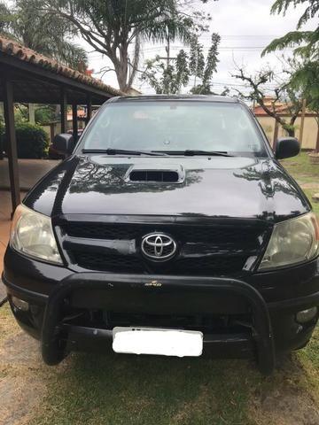 Toyota Hilux CD SR 4x2 4 portas preta em perfeito estado - Foto 3