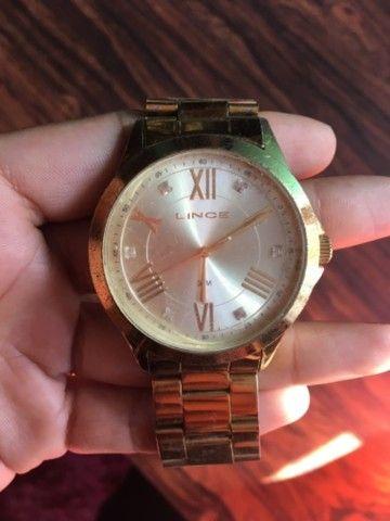 Relógio dourado Lince