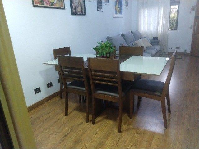 Excelente conjunto de mesa com 6 cadeiras em madeira /vidro
