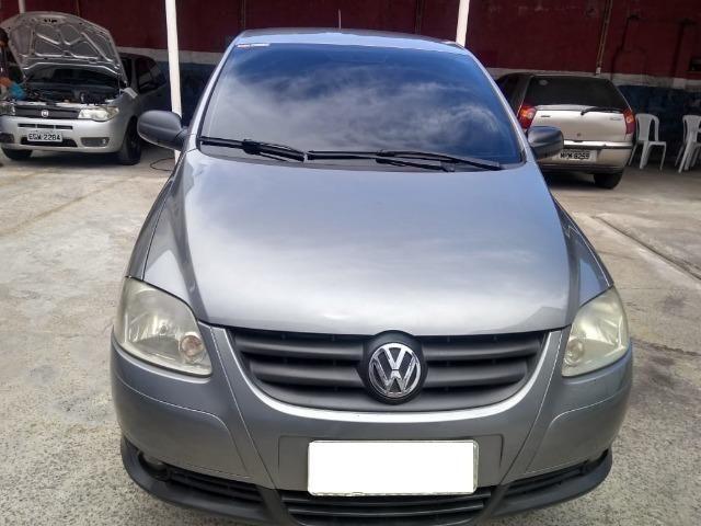 Vw - Volkswagen Fox Flex 1.0 ano 2007 mod. 2008 cinza 4 portas completo som rodas troco