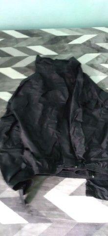 Capa de chuva nova E capacete
