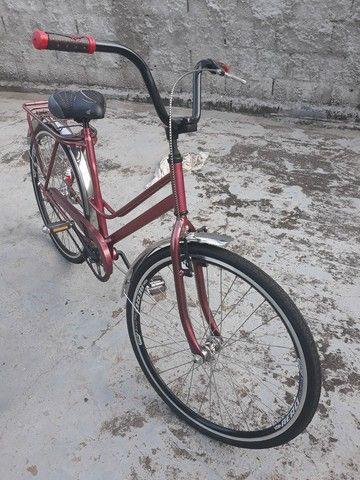 Vendo Uma bicicleta antiga Caloi Pott tudo novo - Foto 2