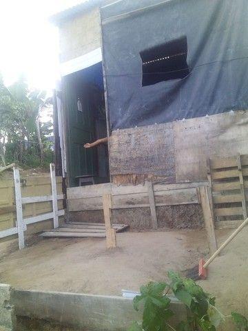 Vendo uma casa de madeira