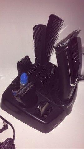 Maquina de cortar cabelo e barbear mondial - Foto 4