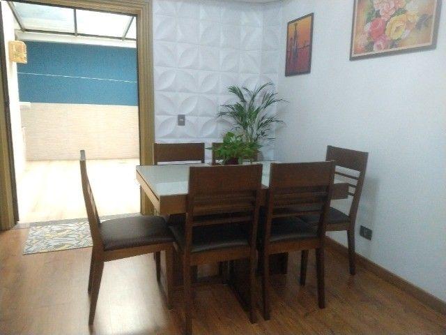 Excelente conjunto de mesa com 6 cadeiras em madeira /vidro - Foto 4