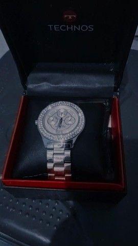 Relógio novinho na caixa