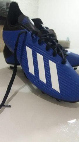 Chuteira de campo Nova Adidas