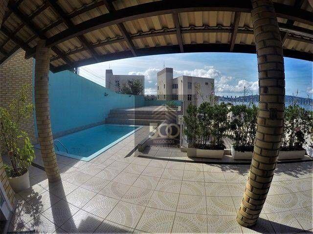 Casa 4 dormitórios, piscina e sala comercial anexa à venda em Coqueiros - Florianópolis/SC - Foto 2