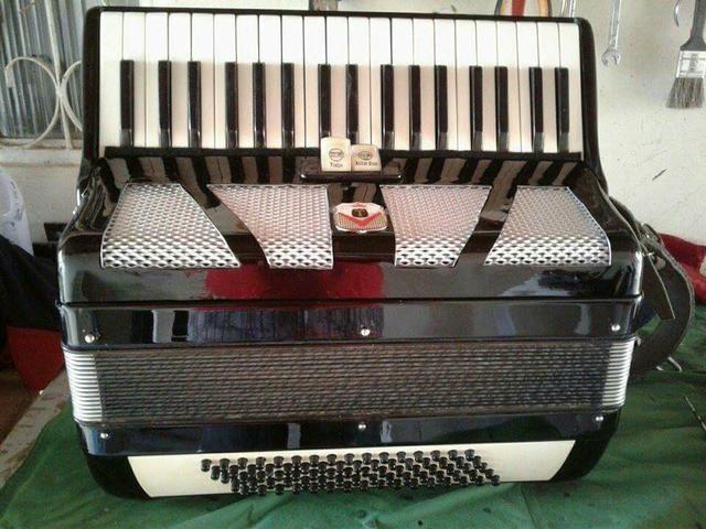 Tampa para acordeon