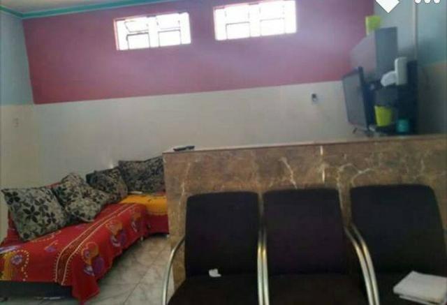 Casa com três quartos, suíte, garagem, área de serviço - Foto 2