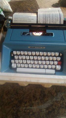 Máquina datilografia  portátil olivete na caixa - Foto 2