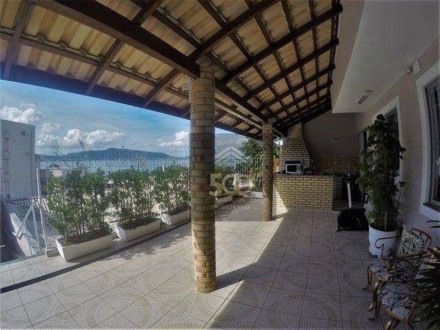 Casa 4 dormitórios, piscina e sala comercial anexa à venda em Coqueiros - Florianópolis/SC - Foto 3