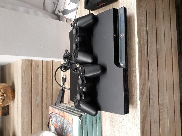 Ps3 160GB usado + 2 controles + 5 jogos