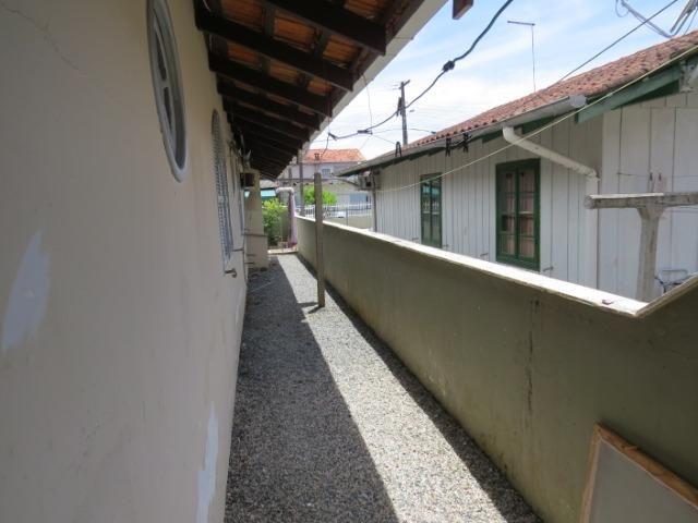 Excelente casa no Balneário Enseada com 3 quartos com ar condicionado - Foto 19