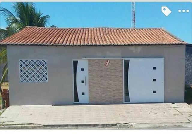 Casa com três quartos, suíte, garagem, área de serviço