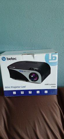 Vendo ou troco mini Projetor Betec 1600 lumens