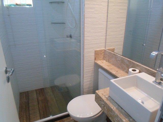 2/4 serviço e varanda, porcelanato, armários e ar condicionado - Foto 9