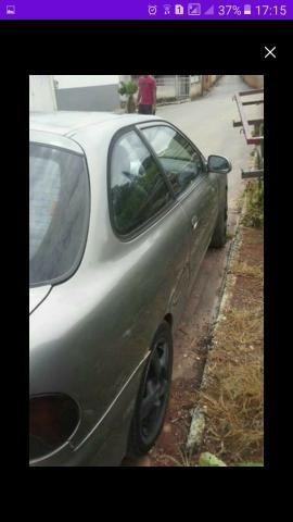 Vendo ou troco carro possui 800 reais de doc - Foto 2
