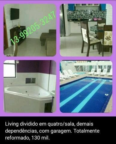 Sala living dividido no centro de SV