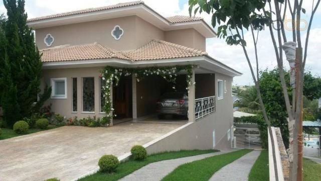 Casa com 4 dormitórios à venda, 347 m² por R$ 1.700.000 - Condomínio Campos de Santo Antôn
