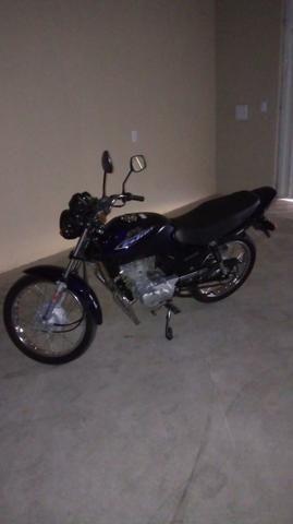 Moto 2003 toda original de fábrica