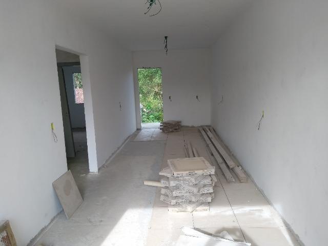 Casa e dois apartamentos em construção - Foto 8