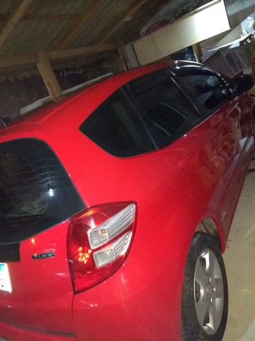 Vendo Honda fit 2009 vermelho 31 mil - Foto 4