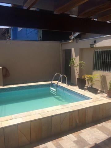 Casa em itanhaem com piscina centro