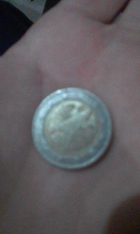 1 moeda boliviana e 2 euros alemão
