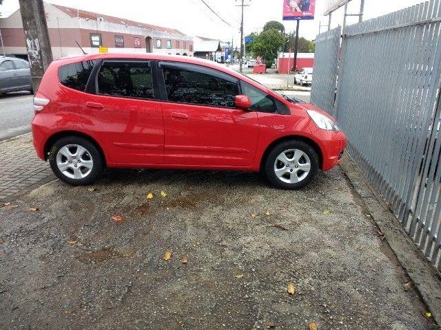 Vendo Honda fit 2009 vermelho 31 mil - Foto 6