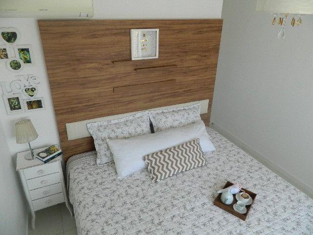Capoeiras 2 dormitórios com muito espaço , suíte e sacada com garagem - Foto 14