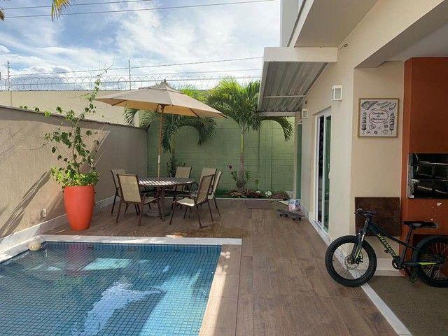 Excelente imóvel a venda 4|4 sendo 4 suítes, piscina, área goumert e fino acabamento - Foto 12