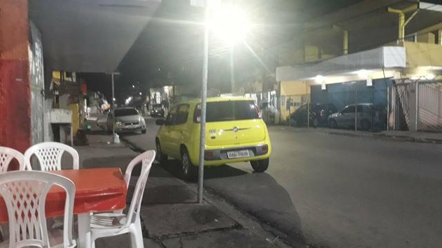 Vendo carro Fiat uno vivace 1.0 amarelo ano 2011/2012 $9.000 mais 32×700 - Foto 4