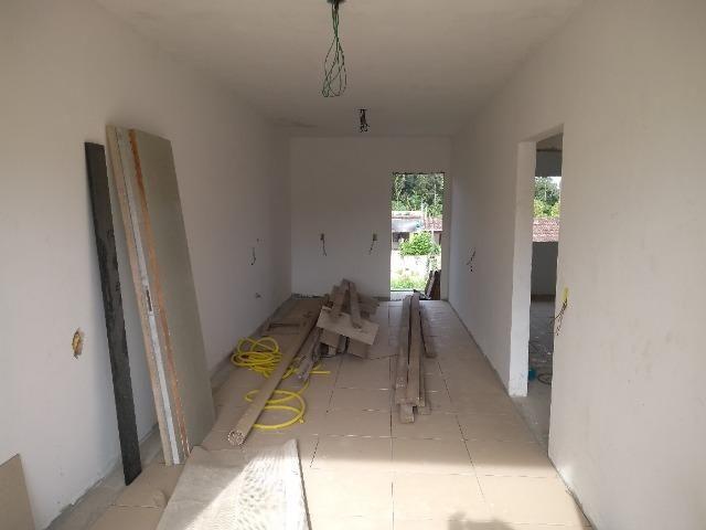 Casa e dois apartamentos em construção - Foto 9