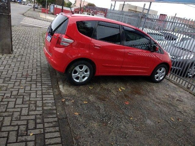 Vendo Honda fit 2009 vermelho 31 mil - Foto 7