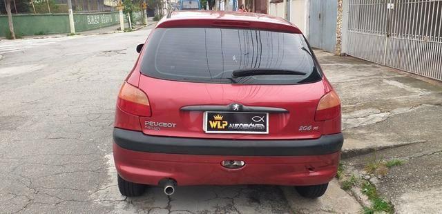 Peugeot 206 entrada de 2000 e 48 de 530 faz com score baixo - Foto 13